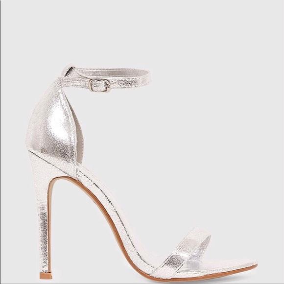 2be1943da7c6e3 Clover Silver Metallic Strap Heeled Sandals. M 5b8883b99519962c9d5f73d3